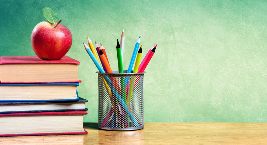 a red apple sitting on top a stack of 5 books next to a stack of pencils in a cup
